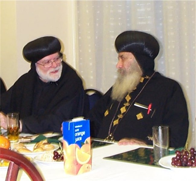 Abba Seraphim chatting with HH Pope Shenouda, 2002